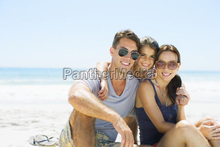 portrait of smiling family hugging on