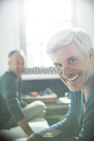 gay couple relaxing together with record