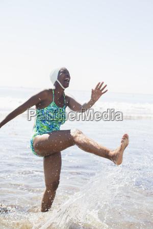 woman splashing in ocean surf