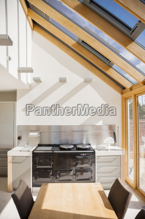 stove and table in modern kitchen