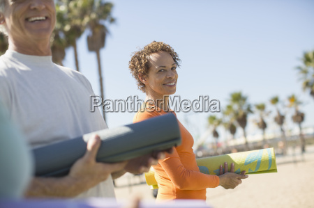 portrait of smiling woman with yoga