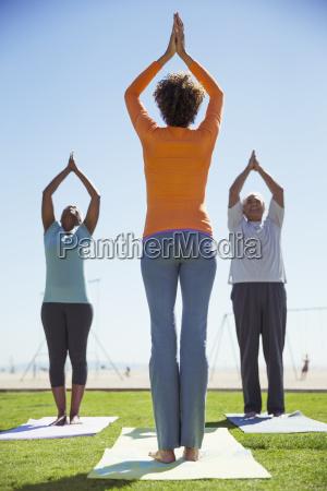 yoga class in sunny park