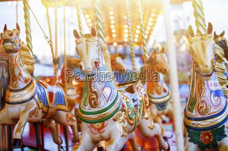 carousel horses in amusement park