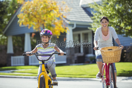 mother and daughter riding bicycles in