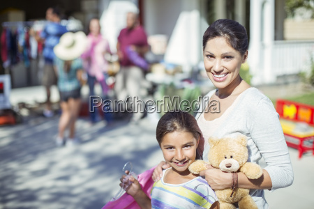 portrait of mother and daughter shopping