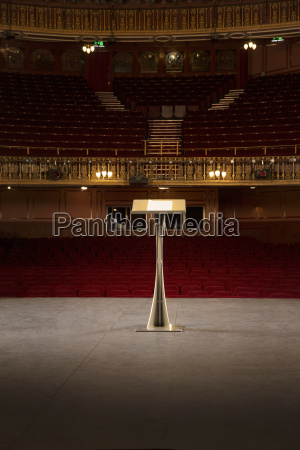 podium on stage in empty theater