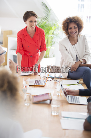 women talking during business meeting