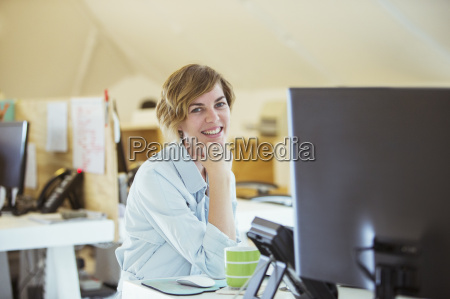 portrait of woman smiling in office