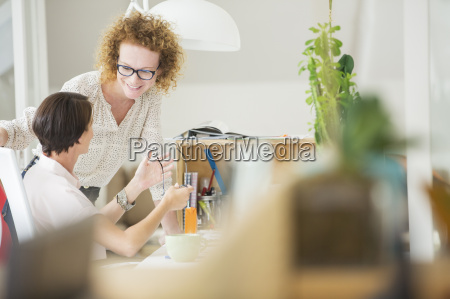 women talking and smiling in office