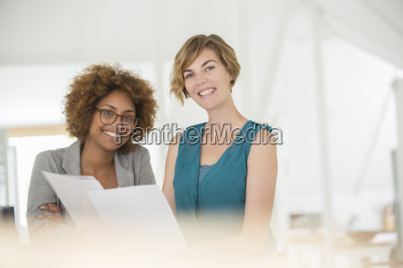 portrait of two smiling office workers