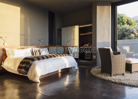 armchair and bed in modern bedroom