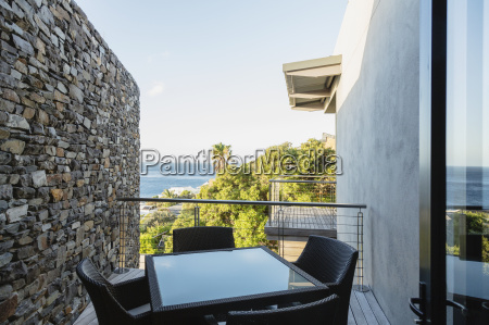 table and chairs on luxury balcony