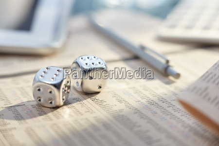 close up of silver dice with