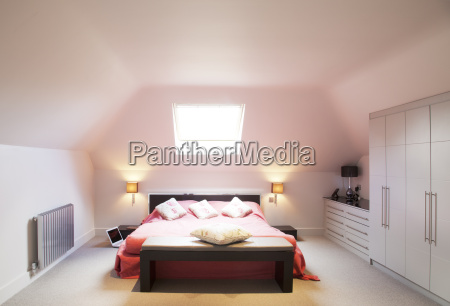 bed and window in modern bedroom