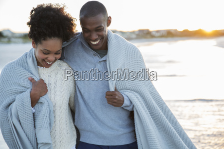 portrait of couple wrapped in blanket