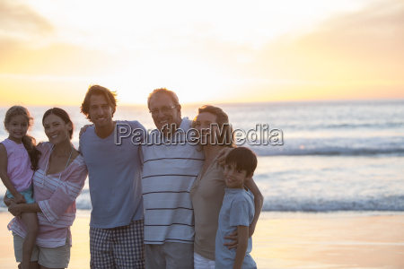 family smiling together on beach