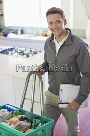 worker with delivery in kitchen