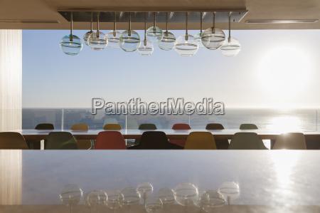long dining table overlooking ocean