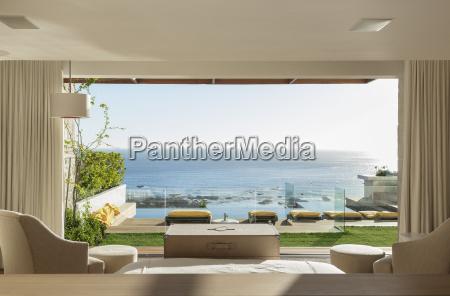 sunny bedroom and patio overlooking ocean
