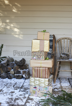 stack of christmas gifts on snowy