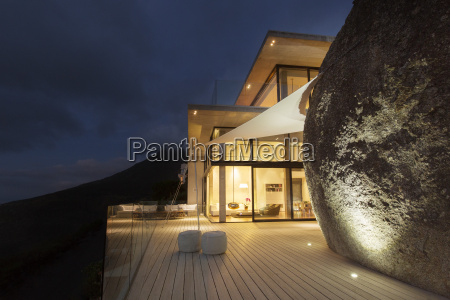 illuminated modern house with rock feature