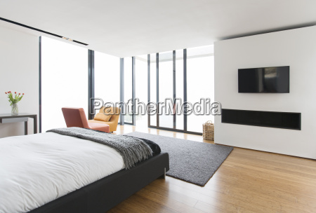 bed and sliding glass doors in