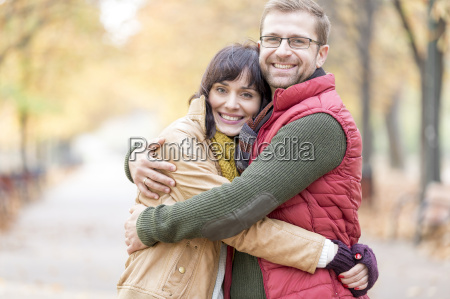 portrait of smiling couple hugging in