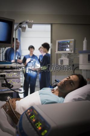patient lying in bed in intensive