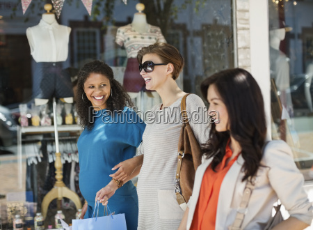 women shopping together on city street