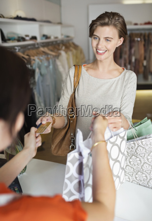 woman shopping in clothes store