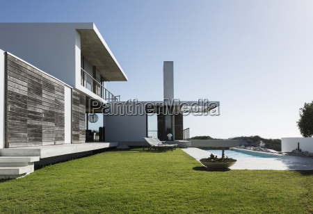lawn and lap pool outside modern