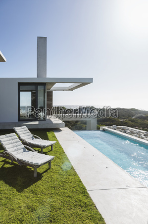 lounge chairs and lap pool outside
