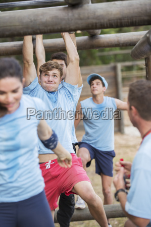 determined people crossing monkey bars on