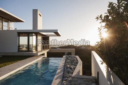 modern, house, overlooking, beach, at, sunset - 17180206