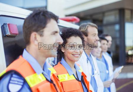 paramedics doctors and nurses smiling by