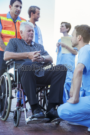 nurse talking to patient outside hospital