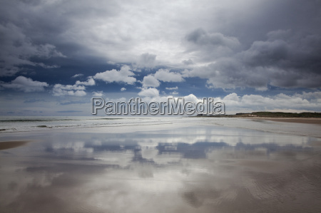reflection of clouds on beach at