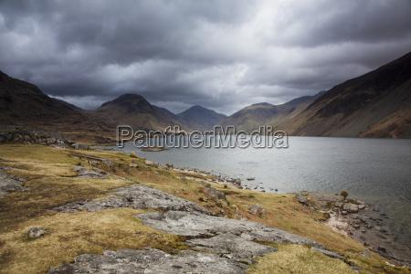 rocky hills surrounding lake