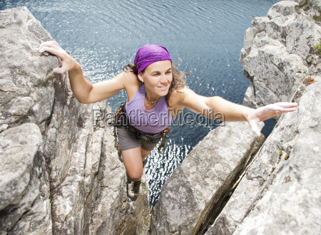 climber scaling rock formation