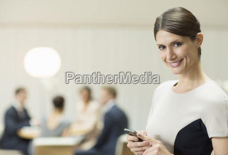 businesswoman using cell phone in office
