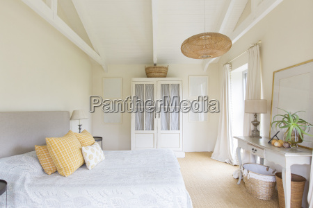 bed and cabinet in bedroom of