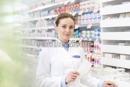 portrait of confident pharmacist holding prescription