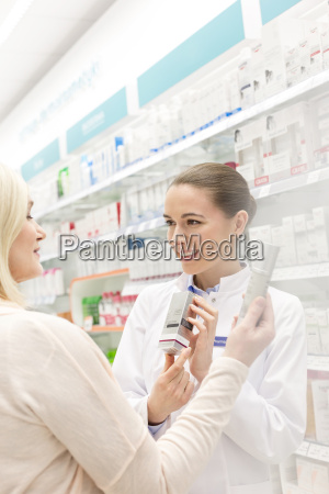 pharmacist recommending product to customer in