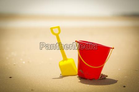shovel and pail on sandy beach