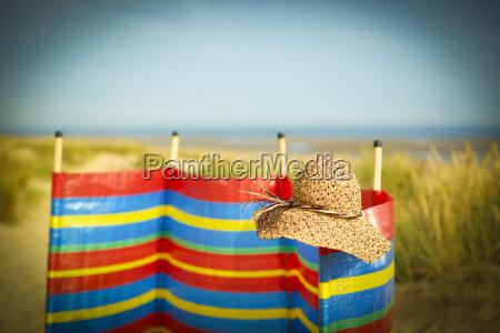 straw hat on wind barrier on