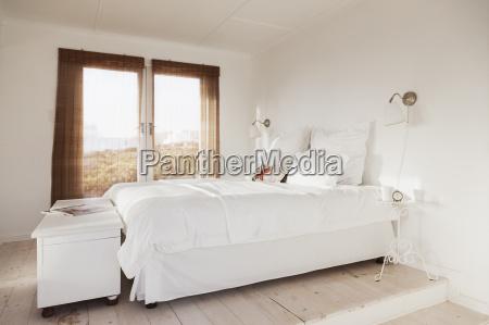 bed in white bedroom