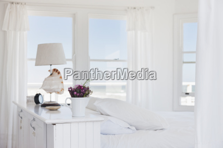 shell lamp in bedroom overlooking ocean