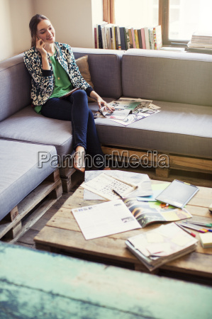 creative businesswoman reviewing proofs and talking