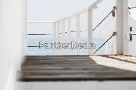 wooden balcony overlooking ocean