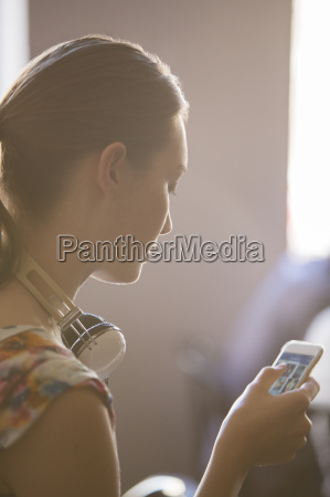 close up woman with headphones using